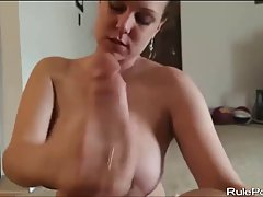 Cock loving woman with big milk jugs is kneeling on the floor and sucking hard cock