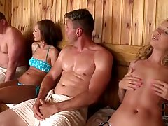 Slim girl with small tits and blonde hair is fucking her friend in the sauna